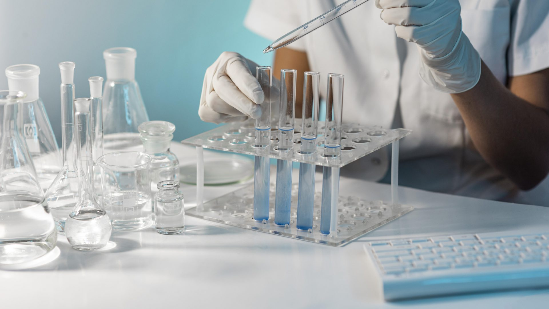close-up-scientist-holding-tube-pipette