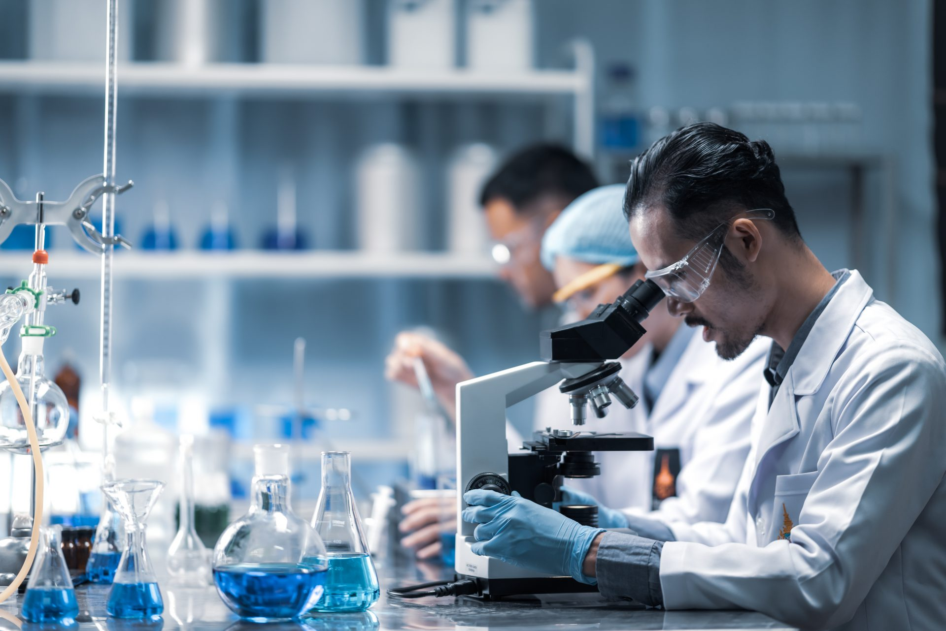 young-scientist-looking-through-microscope-laboratory-young-scientist-doing-some-research